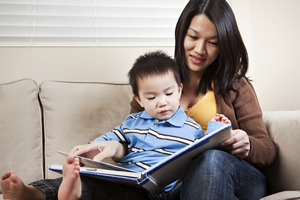 Photo of Mother and Boy reading a book