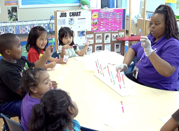 Learning to brush teeth in a Head Start classroom