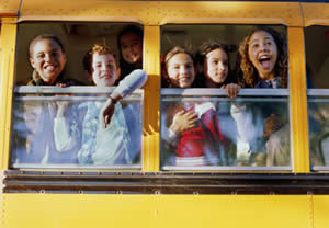 Photo of kids on a school bus