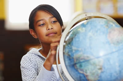 Child using a World Globe.