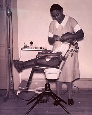 African American Dental Hygienist Treating A Young Patient