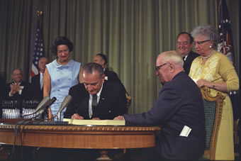 President Lyndon Johnson signing Medicare and Medicaid bill